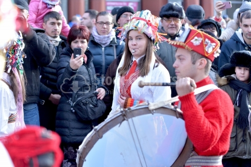 Teenagers dressed for the annual festival of winter traditions and customs. Drummer. Romania