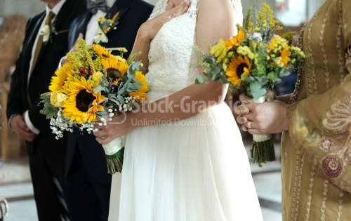 The bride and groom in the church. The sunflower is part of the wedding theme.nd groom in the church.