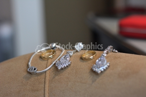 The groom's wedding rings and the bride's jewelry.