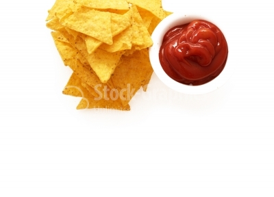 Tomato ketchup, soft focus with tortila chips
