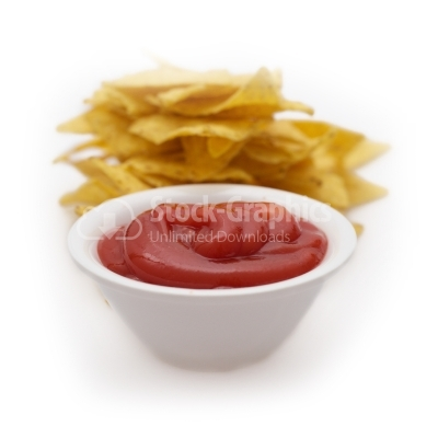 Tomato ketchup with chips behind