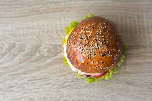 Top view BBQ burger wooden background