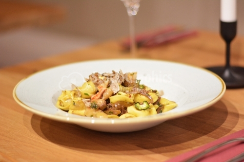 Tortellini pasta with pork and dehydrated vegetables.
