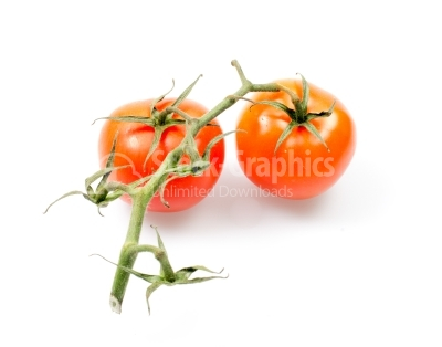 Two fresh tomatoes with green leaves isolated on white backgroun
