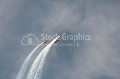 Vapour trail on the cloudy sky
