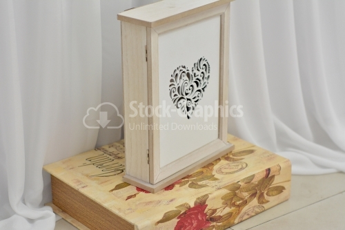 Vertical wooden box with perforated heart-shaped front