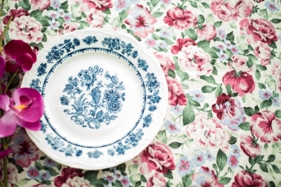 Vintage dinner plate with orchid flower to the left
