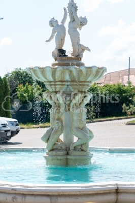 Water fountain made of marble statues