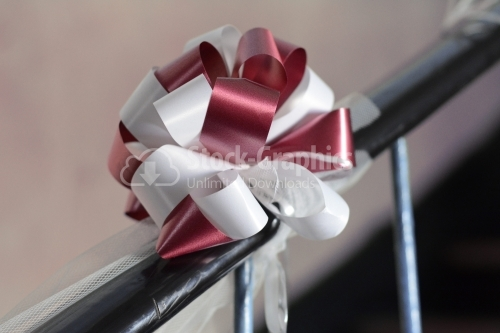 Wedding bow tied up on stairs