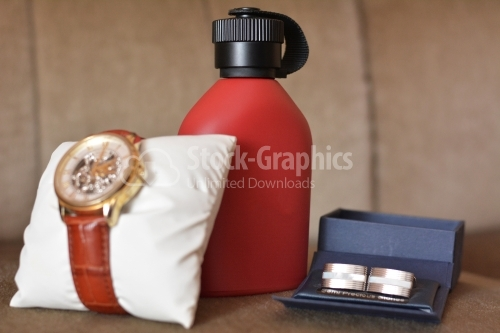 Wedding details. Set of groom accessories on wedding day. Men's watch, perfume and cufflinks.