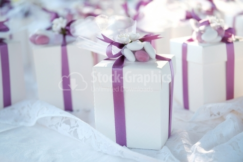 Wedding gift boxes with white and pink ribbons