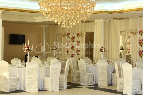 Wedding room with lots of tables and chairs