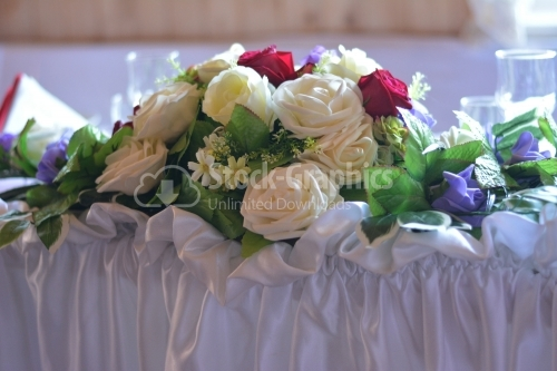 White bouquet of roses on the table