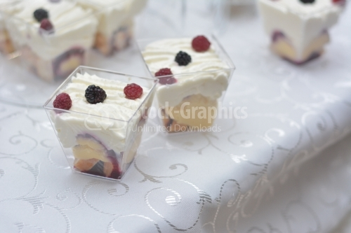 White cream and fruits pudding decorated with raspberries and blackberries