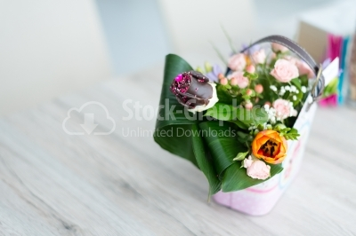 White-wooden table with a bouquet of spring flowers
