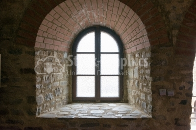 Window in a brick, old structure