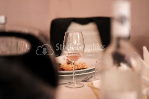 Wine glass on the table of a restaurant
