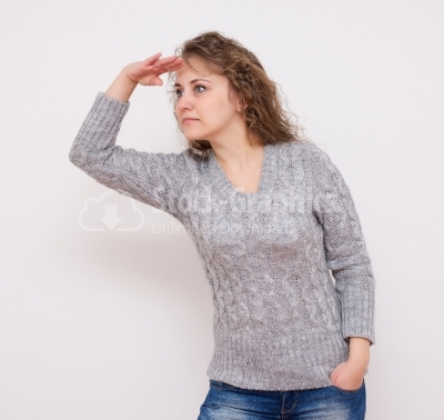 Woman looking far away, over a white background