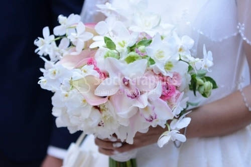 Wonderful bridal bouquet. Lily, roses, orchids.