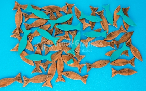 Wood fish on blue background