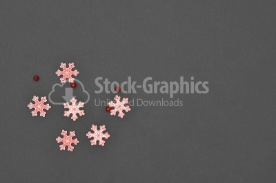Wood snowflakes on dark background
