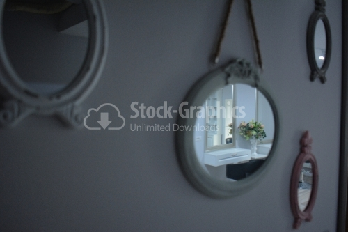 Wooden framed mirror on wall at home