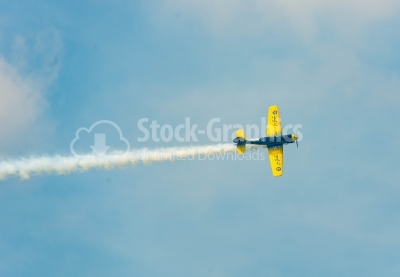 Yellow propeller plane flying