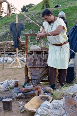 Young Blacksmith working on a ancient festival