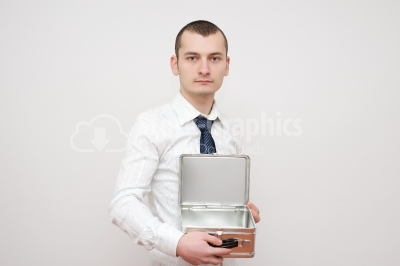 Young businessman with a open metal box