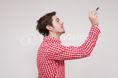 Young guy drawing sideways on a virtual card