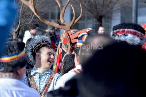 Young man dressed in the traditional romanian port. Goat game.The annual Winter Traditions and Customs Festival.