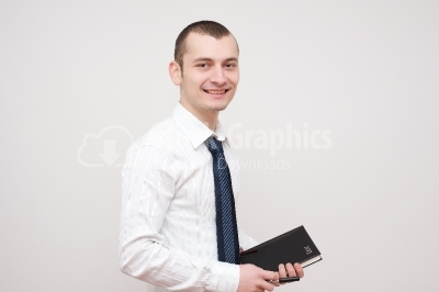 Young man with a notebook